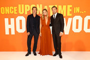 (L-R)  Brad Pitt, Margot Robbie and Leonardo DiCaprio attend the UK Premiere of Once Upon A Time...In Hollywood at Odeon Luxe Leicester Square on July 30, 2019 in London, England.