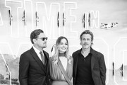 "Image has been converted to black and white)  Leonardo DiCaprio, Margot Robbie and Brad Pitt attend the ""Once Upon a Time... in Hollywood"" UK Premiere at the Odeon Luxe Leicester Square on July 30, 2019 in London, England."