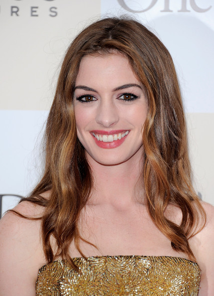 "Actress Anne Hathaway poses for a photo on the red carpet at the ""One Day"" premiere at the AMC Loews Lincoln Square 13 theater on August 8, 2011 in New York City."