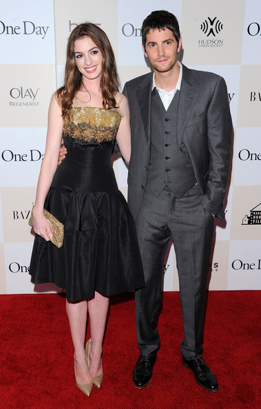 "Actors Anne Hathaway and Jim Sturgess pose for a photo on the red carpet at the ""One Day"" premiere at the AMC Loews Lincoln Square 13 theater on August 8, 2011 in New York City."