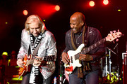 Singer Joe Walsh (L) of the Eagles and Nathan East (R) perform onstage during the One Love Malibu Festival at King Gillette Ranch on December 02, 2018 in Malibu, California.