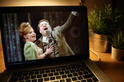 """In this photo illustration, James Corden is seen on the screen of a laptop streaming """"One Man, Two Guvnors"""" during a """"National Theatre at Home"""" broadcast on April 2, 2020 in London, England. Due to Government's guidelines amid the Coronavirus pandemic, theatres have had to close their doors. This is part of """"National Theatre At Home"""" series, bringing the stage to the screen by streaming several iconic plays on YouTube every Thursday."""