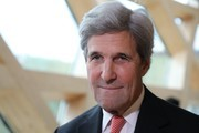 "Former US secretary of state John Kerry smiles during the One Planet Summit on December 12, 2017 at La Seine Musicale venue on l'ile Seguin in Boulogne-Billancourt, west of Paris..?The French President hosts 50 world leaders for the ""One Planet Summit"", hoping to jump-start the transition to a greener economy two years after the historic Paris agreement to limit climate change. / AFP PHOTO / LUDOVIC MARIN"