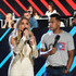 """In this handout photo provided by One Voice: Somos Live!, singers Jennifer Lopez and Maxwell speak onstage during """"One Voice: Somos Live! A Concert For Disaster Relief"""" at the Universal Studios Lot on October 14, 2017 in Los Angeles, California."""