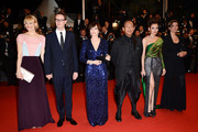 (L-R) Liv Corfixen, director Nicolas Winding Refn, Kristin Scott Thomas, actors Vithaya Pansringarm, Rhatha Phongam and producer Lene Borglum attend the 'Only God Forgives' Premiere during the 66th Annual Cannes Film Festival at Palais des Festivals on May 22, 2013 in Cannes, France.