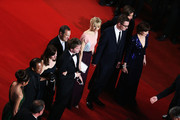 (L-R) Producer Lene Borglum, actress Rhatha Phongam, actor Vithaya Pansringarm, actress Kristin Scott Thomas, director Nicolas Winding Refn, his wife Liv Corfixen, musician Cliff Martinez, and Matthew Newman attend the 'Only God Forgives' Premiere during the 66th Annual Cannes Film Festival at Palais des Festivals on May 22, 2013 in Cannes, France.