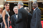 Jury Member Martina Gusman with Jury President Robert De Niro and Jury Member Mahamat-Saleh Harounattend the Opening Ceremony at the Palais des Festivals during the 64th Cannes Film Festival on May 11, 2011 in Cannes, France.