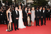 (L-R) Jury Member Martina Gusman with Jury President Robert De Niro and Jury Members Uma Thurman,Olivier Assayas,Nansun Shi,Linn Ullmann,Mahamat-Saleh Haroun,Jude Law,Johnnie To attend the Opening Ceremony at the Palais des Festivals during the 64th Cannes Film Festival on May 11, 2011 in Cannes, France.