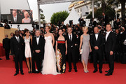 Jury Members Olivier Assayas, Jude Law, Nansun Shi, Linn Ulmann, Johnnie To, Jury President Robert De Niro, Jury Members Uma Thurman, Mahamat-Saleh Haroun and Martina Gusman attend the Opening Ceremony at the Palais des Festivals during the 64th Cannes Film Festival on May 11, 2011 in Cannes, France.