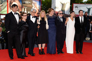 Jiang Wen, Carrie Fisher, Ryuichi Sakamoto, Andrea Ardnold, Martina Gedek, Renato Berta, Virginie Ledoyen and Pablo Larrain attend the Opening Ceremony And 'Gravity' Premiere during the 70th Venice International Film Festival at the Palazzo del Cinema on August 28, 2013 in Venice, Italy.