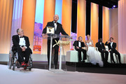 (L-R) Filmmaker Bernardo Bertolucci, President of the Cannes Film Festival Gilles Jacob, Jury members Robert De Niro, Uma Thurman,  Mahamat-Saleh Haroun and Jude Law onstage at the Opening Ceremony at the Palais des Festivals during the 64th Cannes Film Festival on May 11, 2011 in Cannes, France.