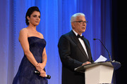 President of the Festival Paolo Baratta speaks on stage next to Festival hostess and actress Luisa Ranieri during the opening ceremony at the 71st Venice Film Festival on August 27, 2014 in Venice, Italy.
