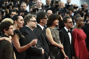 "(L-R) Jury members Xavier Dolan, Sienna Miller, Rossy de Palma, Guillermo del Toro, Joel Coen,  Sophie Marceau Ethan Coen and Rokia Traore attend the opening ceremony and premiere of ""La Tete Haute"" (""Standing Tall"") during the 68th annual Cannes Film Festival on May 13, 2015 in Cannes, France."