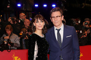"""Member of the International Jury Berenice Bejo (L) and Michel Hazanavicius arrive for the opening ceremony and """"My Salinger Year"""" premiere during the 70th Berlinale International Film Festival Berlin at Berlinale Palace on February 20, 2020 in Berlin, Germany."""