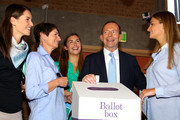 Australian Opposition Leader, Tony Abbott watches as his daughters Bridget, Frances and Louise and his wife Margie vote in the federal election on September 7, 2013 in Sydney, Australia. Polls predict a comfortable victory for the Abbott led conservative Liberal-National Party coalition against the incumbent Australian Labor Party.