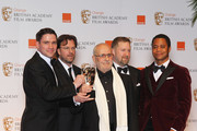 Special Visual Effects award winners Tim Burke, John Richardson, Greg Butler, David Vickery and presenter Cuba Gooding Jr pose in the press room during the Orange British Academy Film Awards 2012 at the Royal Opera House on February 12, 2012 in London, England.