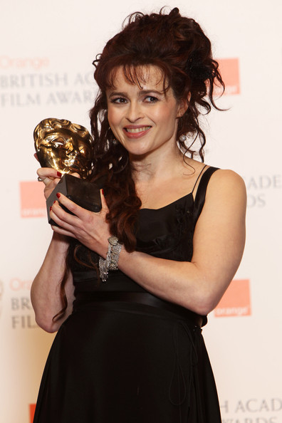 (UK TABLOID NEWSPAPERS OUT) Helena Bonham Carter poses with her Best Supporting Actress award in front of the winners boards at the Orange British Academy Film Awards 2011 held at The Royal Opera House on February 13, 2011 in London, England.