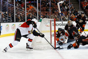 Zack Smith #15 of the Ottawa Senators and Hampus Lindholm #47, Clayton Stoner #3 and Frederik Andersen #31 of the Anaheim Ducks battle for a loose puck in front of the net during the second period of a game at Honda Center on January 13, 2016 in Anaheim, California.