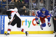 Chris Neil #25 of the Ottawa Senators upends Brady Skjei #76 of the New York Rangers during the first period at Madison Square Garden on December 27, 2016 in New York City.