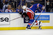 Marc Staal #18 of the New York Rangers checks Chris Neil #25 of the Ottawa Senators during the first period in Game Six of the Eastern Conference Second Round during the 2017 NHL Stanley Cup Playoffs at Madison Square Garden on May 9, 2017 in New York City.