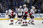 Members of the Ottawa Senators, including Mark Stone #61, Mika Zibanejad #93 and Chris Neil #25 of the Ottawa Senators react to a goal by the Tampa Bay Lightning at the Amalie Arena on December 10, 2015 in Tampa, Florida.