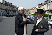 The Respect Party's George Galloway (R) speaks to a man during his election campaigning on April 24, 2015 in Bradford, England. Britain goes to the polls in a General Election on May 7.