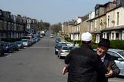 The Respect Party's George Galloway (R) greets a man during his election campaigning on April 24, 2015 in Bradford, England. Britain goes to the polls in a General Election on May 7.