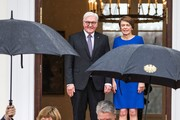 Germany's outgoing President Joachim Gauck (R) and his partner Daniela Schadt (L) leave after the handover ceremony with his successor Frank-Walter Steinmeier (top L) and his wife Elke Buedenbender (top R) at the presidential Bellevue Palace in Berlin on March 19, 2017.  / AFP PHOTO / Odd ANDERSEN