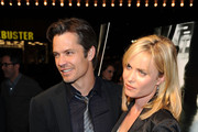 "Actors Timothy Olyphant and Radha Mitchell arrive at Overture's ""The Crazies"" VIP screening at the Vista Theatre on February 23, 2010 in Los Angeles, California."