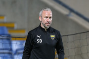 Oxford United first team coach Shaun Derry in action during the pre match warm up prior to the Checkatrade Trophy match between Oxford United and Northampton Town at Kassam Stadium on October 9, 2018 in Oxford, England.
