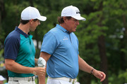 Phil Mickelson and Rory McIlroy Photos Photo