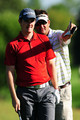 Justin Rose of England (L) chats with his caddie Mark Fulcher during the third preview day of the 91st PGA Championship at Hazeltine National Golf Club on August 12, 2009 in Chaska, Minnesota.