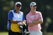 Justin Rose of England waits in the 14th fairway with his caddie Mark Fulcher during the first round of THE PLAYERS Championship on The Stadium Course at TPC Sawgrass on May 8, 2014 in Ponte Vedra Beach, Florida.