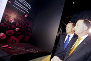 """New Zealand Prime Minister John Key and Australian Prime Minister Tony Abbott look at an exhibit during a tour of """"Gallipoli: The scale of our war"""" exhibition at Te Papa Museum on April 20, 2015 in Wellington, New Zealand. Australian Prime Minister Tony Abbott is in Wellington today as part of commemorations ahead of the 100th anniversary of the ANZAC landings at Gallipoli."""