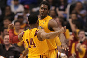 Alex Stepheson #1 and Donte Smith #14 of the USC Trojans celebrate on the court in the second half against the California Golden Bears in the quarterfinals of the 2011 Pacific Life Pac-10 Men's Basketball Tournament at Staples Center on March 10, 2011 in Los Angeles, California.