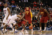 Lamont Jones #12 of the Arizona Wildcats crashes into Marcus Simmons #43 of the USC Trojans in the second half in the semifinals of the 2011 Pacific Life Pac-10 Men's Basketball Tournament at Staples Center on March 11, 2011 in Los Angeles, California.