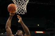 Alex Stepheson #1 of the USC Trojans goes up to dunk the ball against Derrick Williams #23 of the Arizona Wildcats in the first half in the semifinals of the 2011 Pacific Life Pac-10 Men's Basketball Tournament at Staples Center on March 11, 2011 in Los Angeles, California.