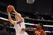 Kyryl Natyazhko #1 of the Arizona Wildcats grabs a rebound over Alex Stepheson #1 of the USC Trojans in the first half in the semifinals of the 2011 Pacific Life Pac-10 Men's Basketball Tournament at Staples Center on March 11, 2011 in Los Angeles, California.