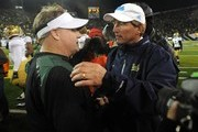 Head coach Chip Kelly of the Oregon Ducks and head coach Rick Neuheisel of the UCLA Bruins shake hands at the end of the Pac-12 Championship game at Autzen Stadium on December 2, 2011 in Eugene, Oregon. The Ducks won the game 49-31 to earn a berth in the Rose Bowl.