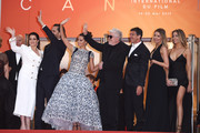 """(L-R) Nieves Alvarez, Asier Etxeandia, Penelope Cruz, wearing Atelier Swarovski Fine Jewelry, Director Pedro Almodovar, Antonio Banderas, Leonardo Sbaraglia, Nicole Kimpel and her twin sister attend the screening of """"Pain And Glory (Dolor Y Gloria/Douleur Et Gloire)"""" during the 72nd annual Cannes Film Festival on May 17, 2019 in Cannes, France."""