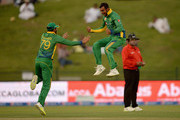 Shoaib Malik of Pakistan celebrates with Azhar Ali after dismissing James Taylor of England during the 1st One Day International between Pakistan and England at Zayed Cricket Stadium on November 11, 2015 in Abu Dhabi, United Arab Emirates.