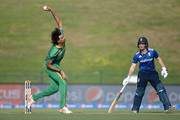 Mohammad Irfan of Pakistan bowls watched by England captain Eoin Morgan during the 1st One Day International between Pakistan and England at Zayed Cricket Stadium on November 11, 2015 in Abu Dhabi, United Arab Emirates.