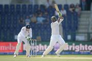 Shoaib Malik of Pakistan bats during day two of the 1st Test between Pakistan and England at Zayed Cricket Stadium on October 14, 2015 in Abu Dhabi, United Arab Emirates.