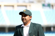 Sarfraz Ahmed of Pakistan walks out for the coin toss during day one of the First Test match in the series between Australia and Pakistan at Dubai International Stadium on October 7, 2018 in Dubai, United Arab Emirates.