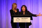 Lisa Kudrow (L)_ and Lily Tomlin appear on stage at The Paley Honors: A Special Tribute To Television's Comedy Legends at the Beverly Wilshire Four Seasons Hotel on November 21, 2019 in Beverly Hills, California.
