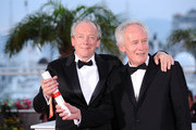 """Directors Luc Dardenne (R) and Jea-Pierre Dardenne, winners of the The Grand Prix award for """"The Kind With A Bike"""" attend the Palme d'Or Winners Photocall at the Palais des Festivals during the 64th Cannes Film Festival on May 22, 2011 in Cannes, France."""