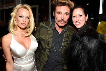 "Pamela Anderson TASCHEN And David Bailey Celebrate ""It's Just A Shot Away: The Rolling Stones In Photographs"" At The TASCHEN Gallery"