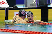 Katie Ledecky (L) of the United States is congratulated after winning the gold medal by Leah Smith (R) of the United States after competing in the Women's Freestyle 800m Timed-Final on day one of the Pan Pacific Swimming Championships at Tokyo Tatsumi International Swimming Center on August 9, 2018 in Tokyo, Japan.
