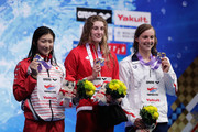(L to R) Silver medalist Rikako Ikee of Japan, gold medalist Taylor Ruck of Canada and bronze medalist Katie Ledecky of the United States celebrate on the podium at the medal ceremony for the Women's 200m Freestyle on day one of the Pan Pacific Swimming Championships at Tokyo Tatsumi International Swimming Center on August 9, 2018 in Tokyo, Japan.