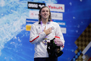 Gold medalist Katie Ledecky of the United States stands on the podium for the national anthem at the medal ceremony for the Women's 400m Freestyle on day three of the Pan Pacific Swimming Championships at Tokyo Tatsumi International Swimming Center on August 11, 2018 in Tokyo, Japan.